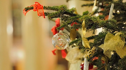 grey bauble hung on Christmas tree