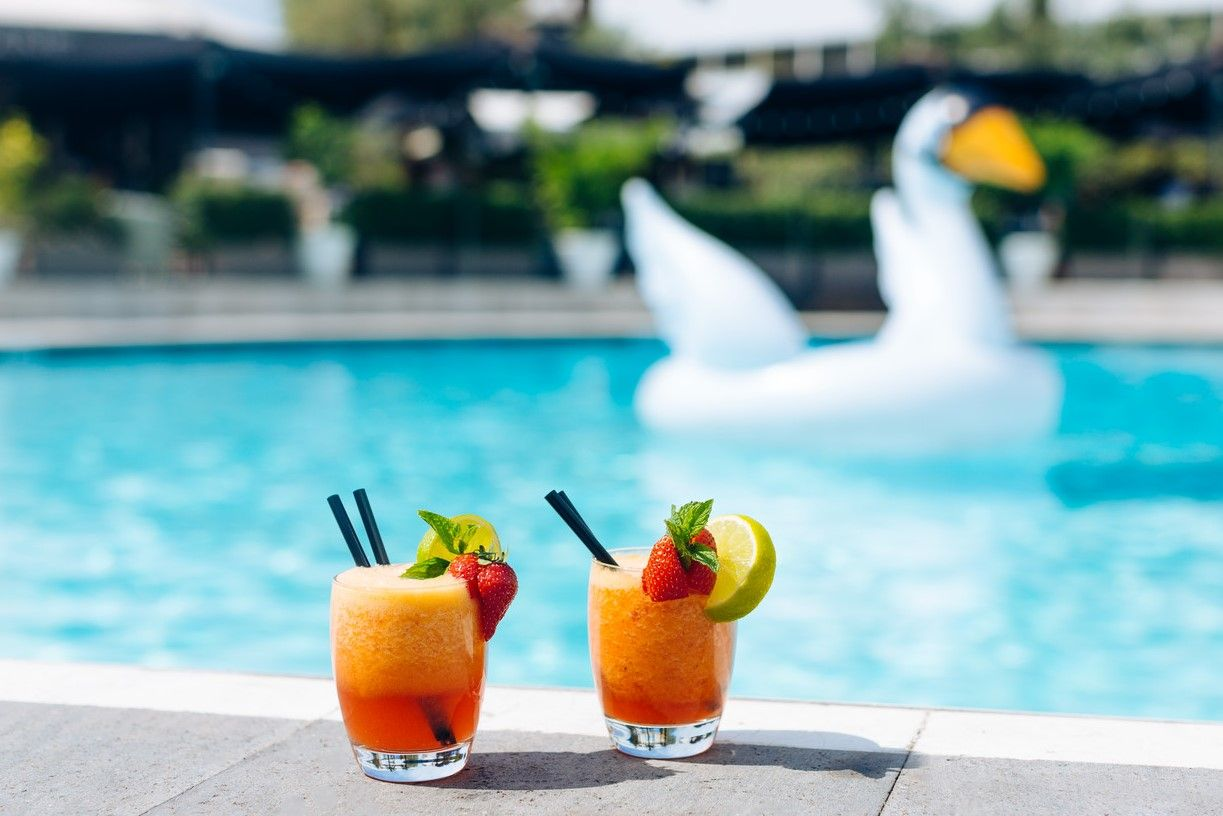 Two drinks at poolside In Rome at Sheraton Roma Hotel & Conference Center