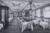 grayscale photo of table and chairs restaurant interior