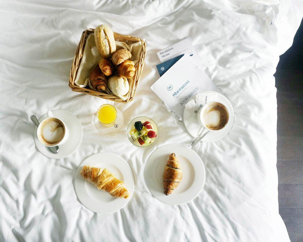 flat lay photography of toasted bread and teacups