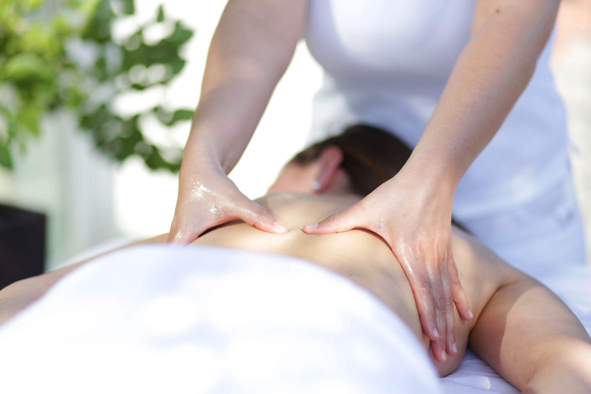 massaging person's back