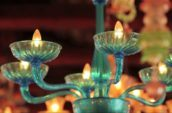 selective focus photography of blue candlelabra chandelier