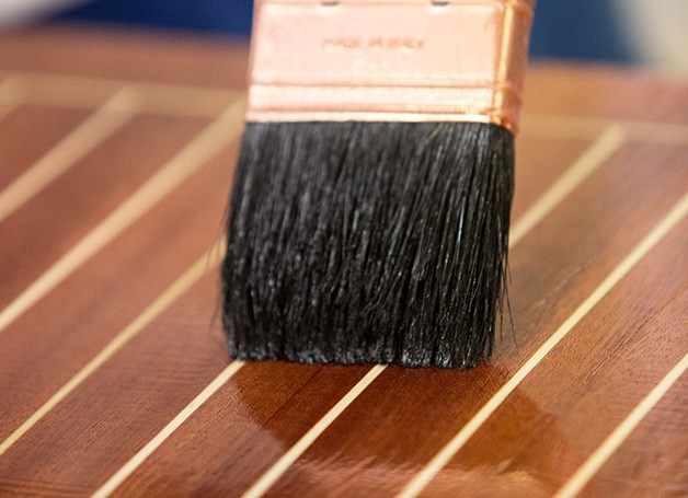 paint brush brushing wood