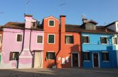 pink, orange, and blue concrete houses