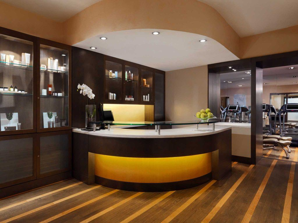 brown wooden reception desk with lighting