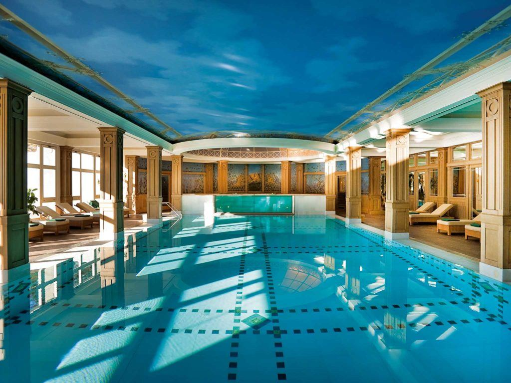 swimming pool in between lounges inside building