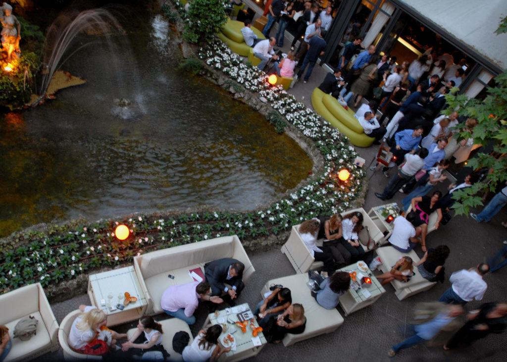 people eating near fountain