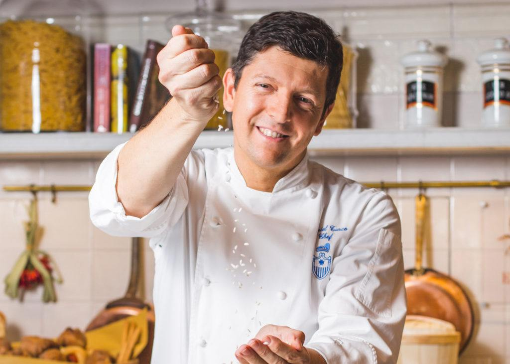 chef standing near cupboard