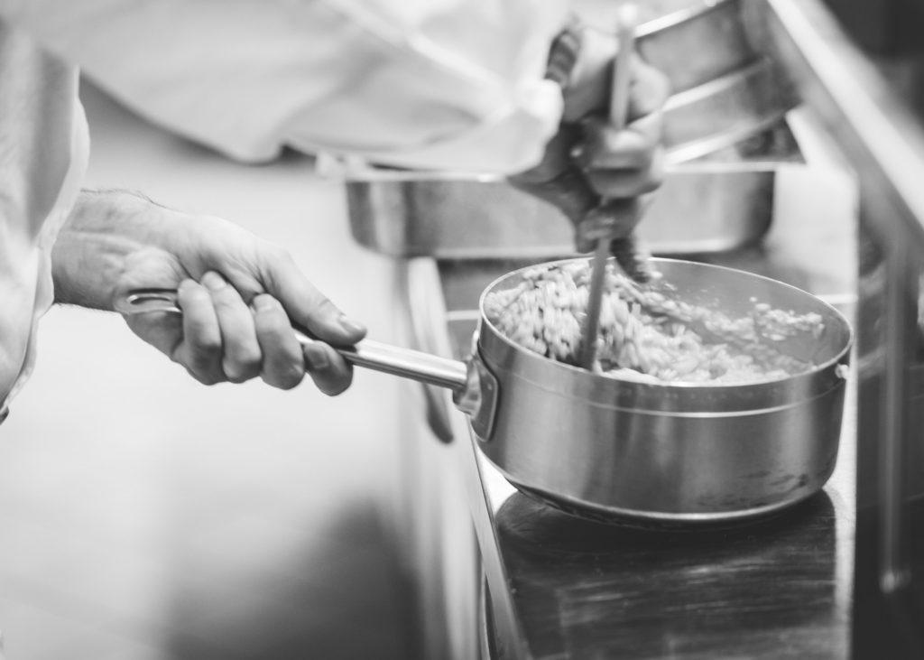 person holding saucepan