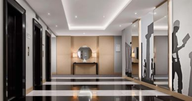 stylish elevator landing of Le Méridien Visconti Rome with black and white striped floors