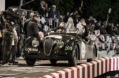 two men riding inside black Alfa Romeo convertible car