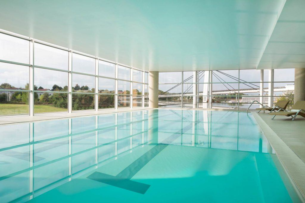 swimming pool inside white room