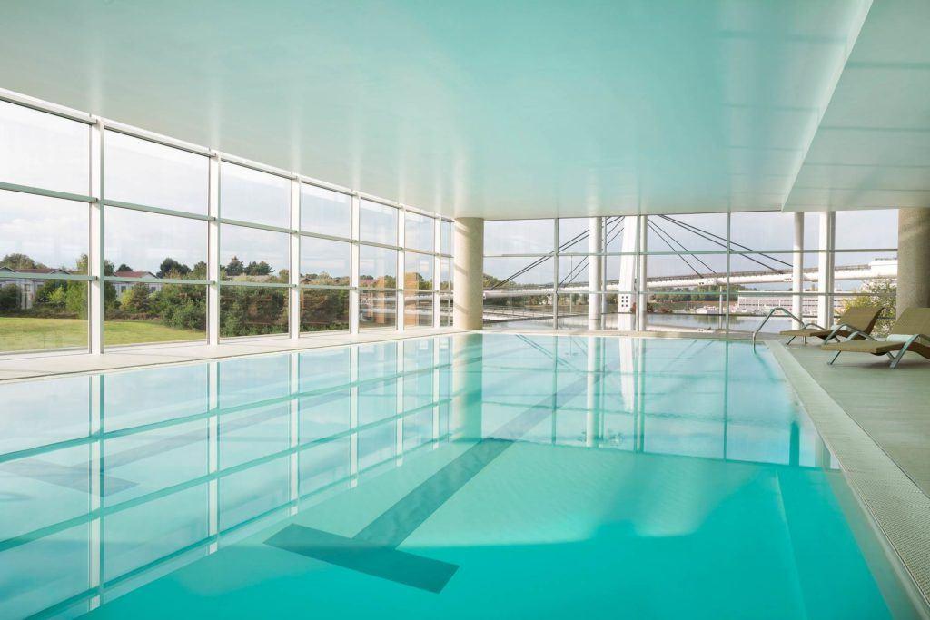 swimming pool inside white room
