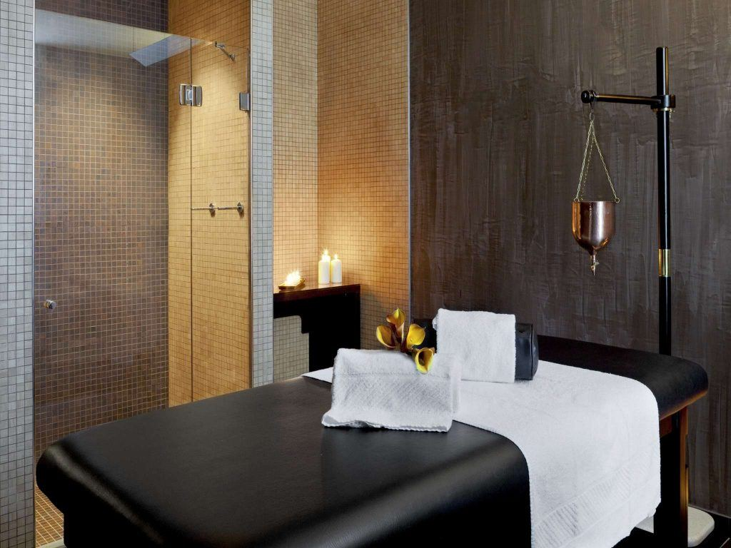 white towel on black bed
