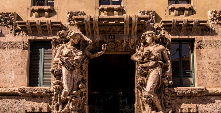 two statues standing near doorway