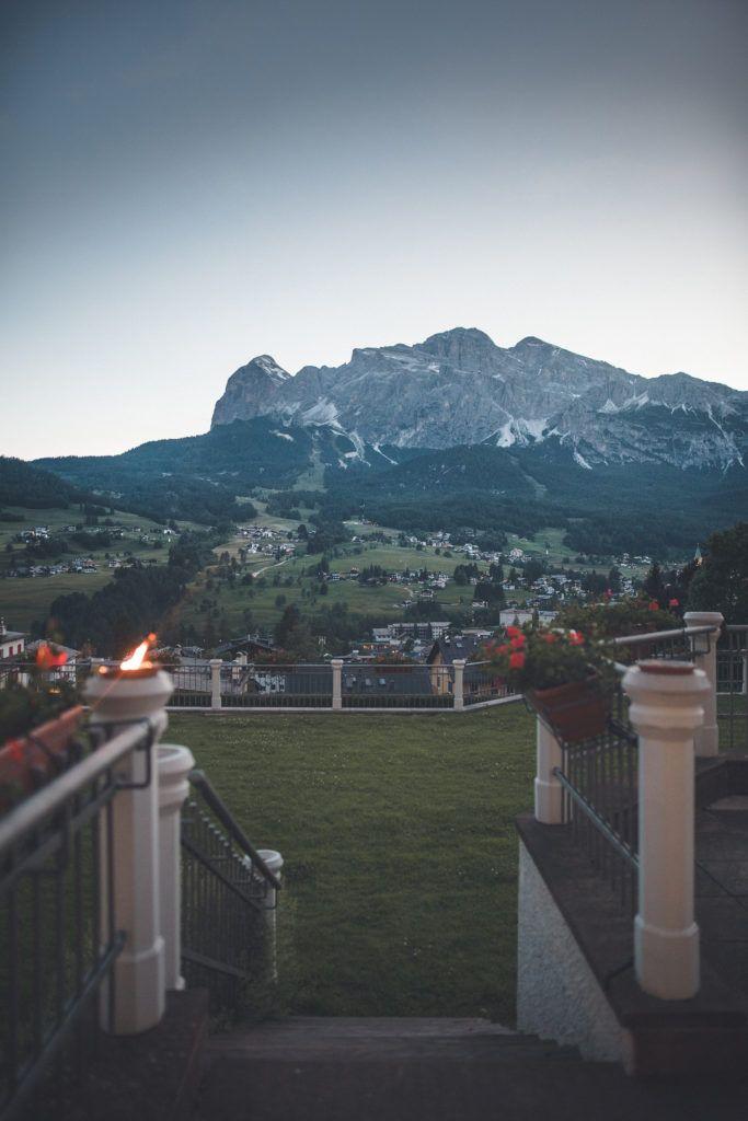 gray rock mountain overlooking town