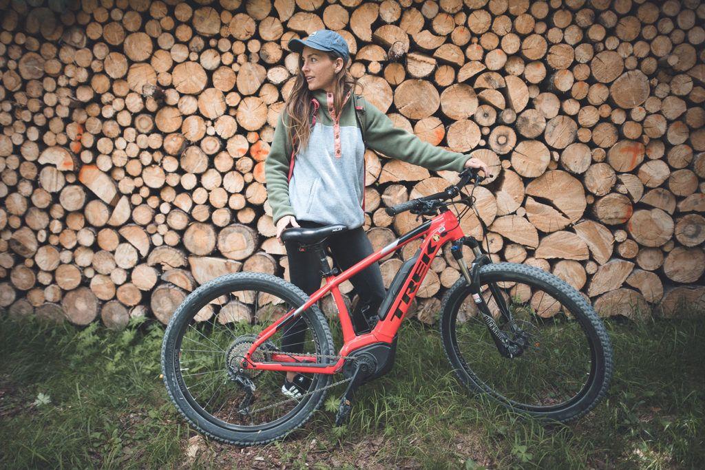 woman holding bike