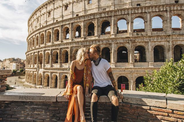 man and woman kissing near Colosseum, Rome at daytime