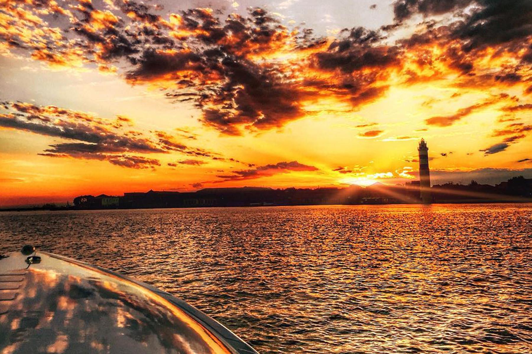 white lighthouse under golden hour