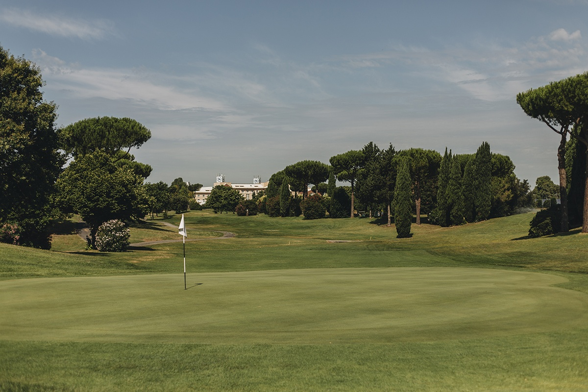 golf course surrounded with trees