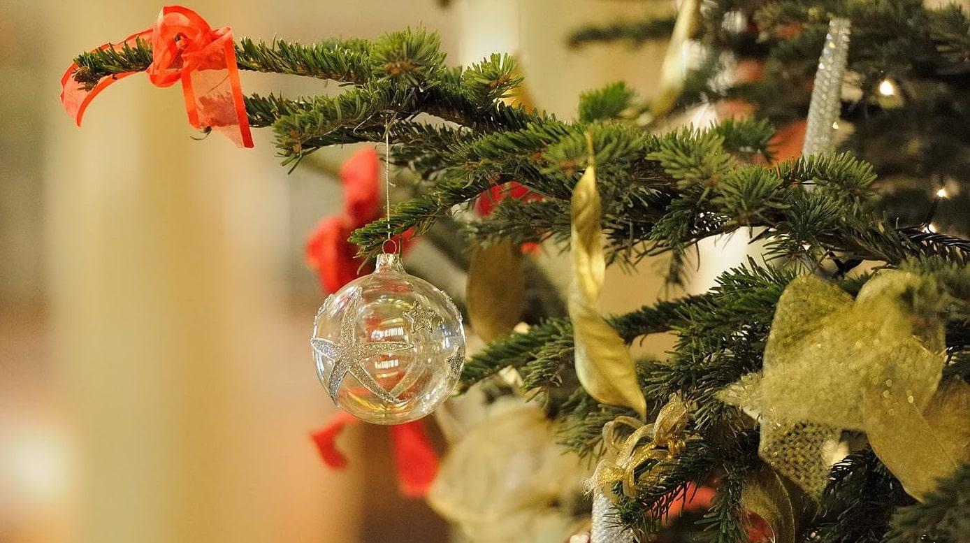 clear Christmas ornament hanged on Christmas tree