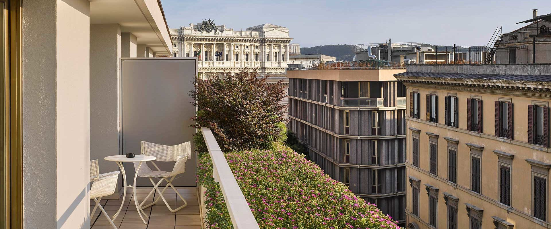 a hotel suite terrace overlooking Rome