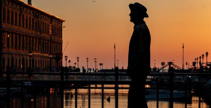 The golden hour in trieste at Canal grande with the Joyce's statue