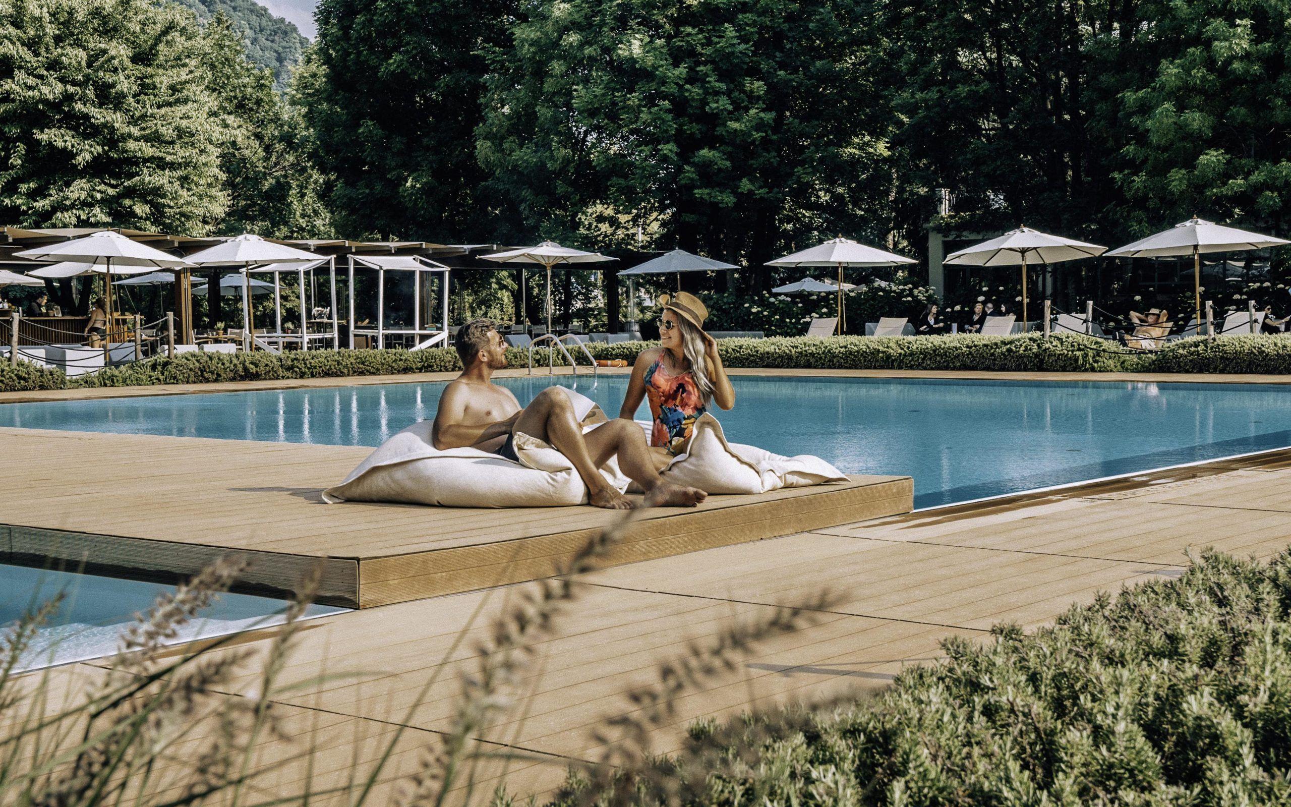 Couple relaxing at poolside at Sheraton Lake Como