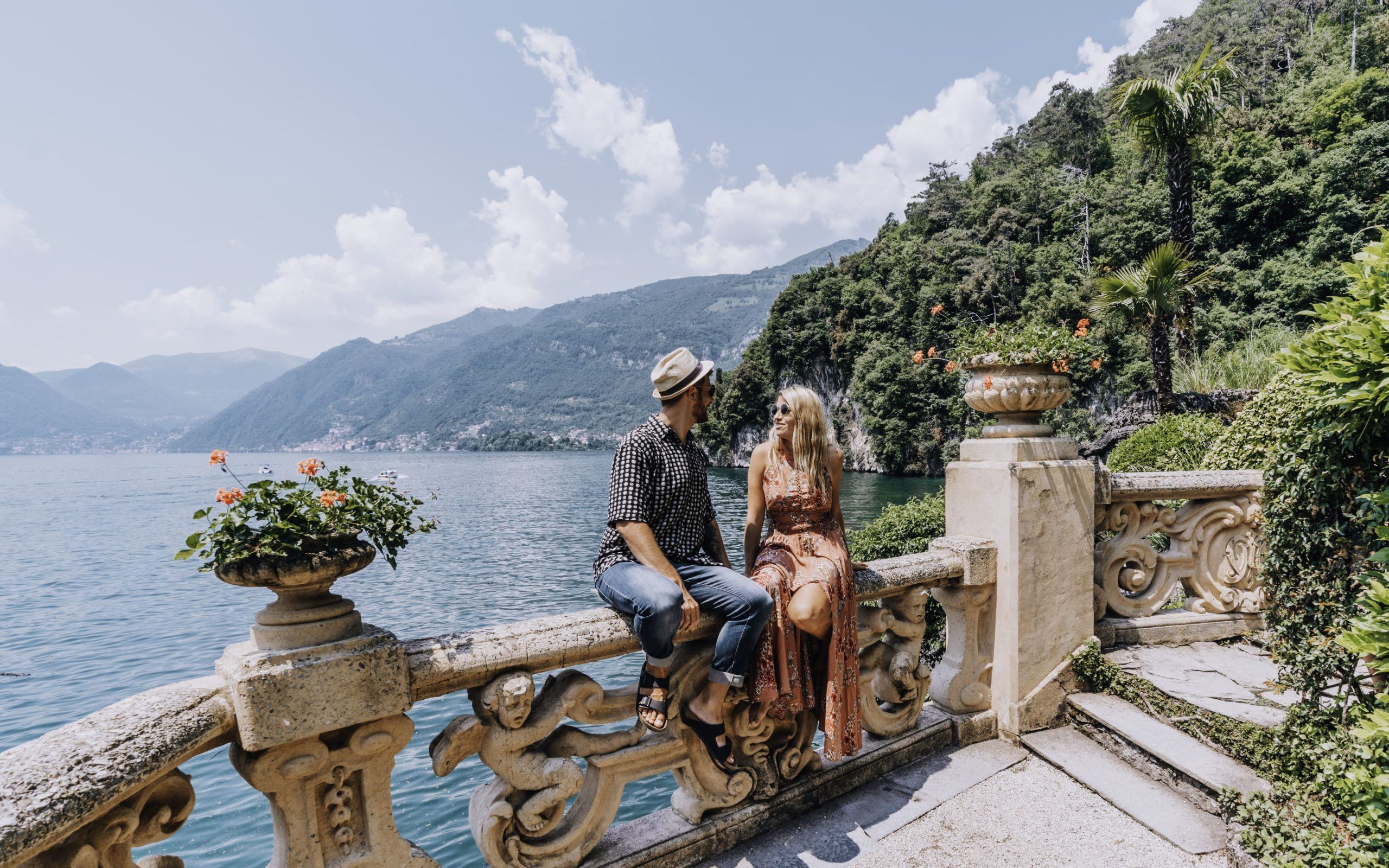 couple sitting outside Villa on Lake Como