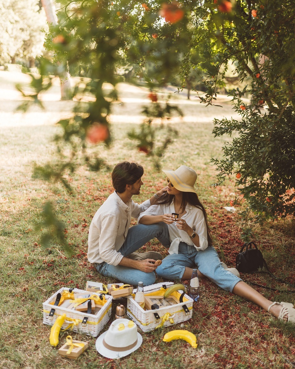 Couple makes a picnic at Villa Borghese Park in Rome