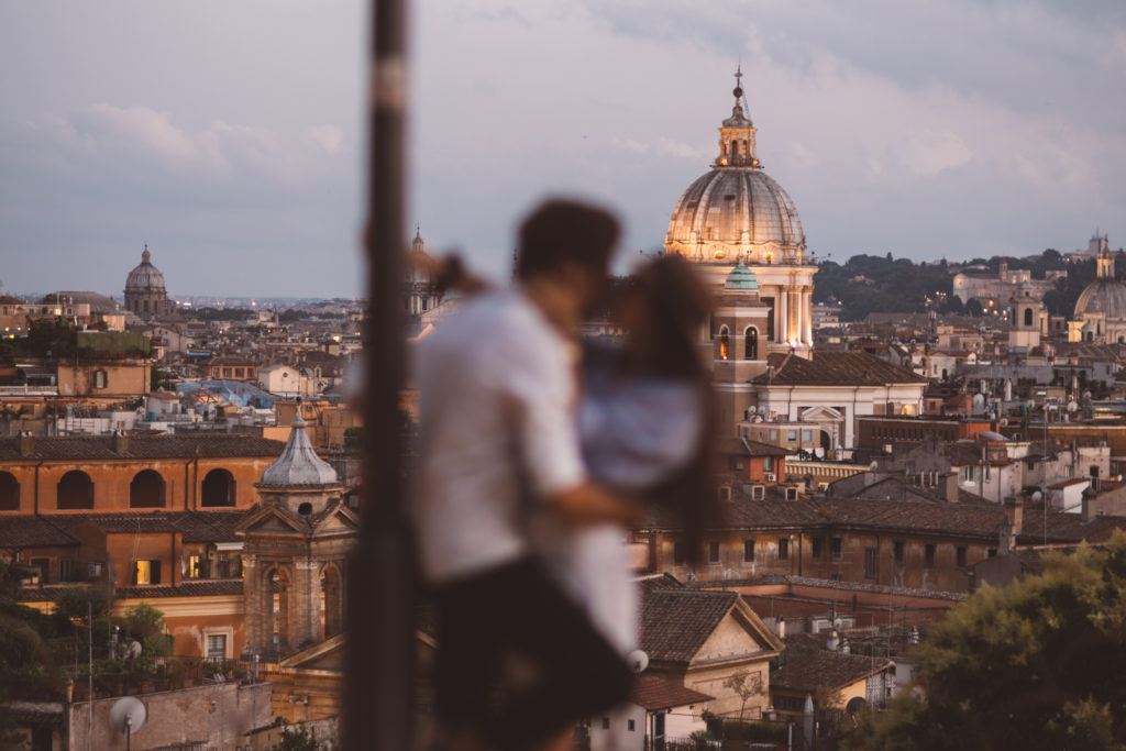 Couple in love kissing in Rome during the golden hour