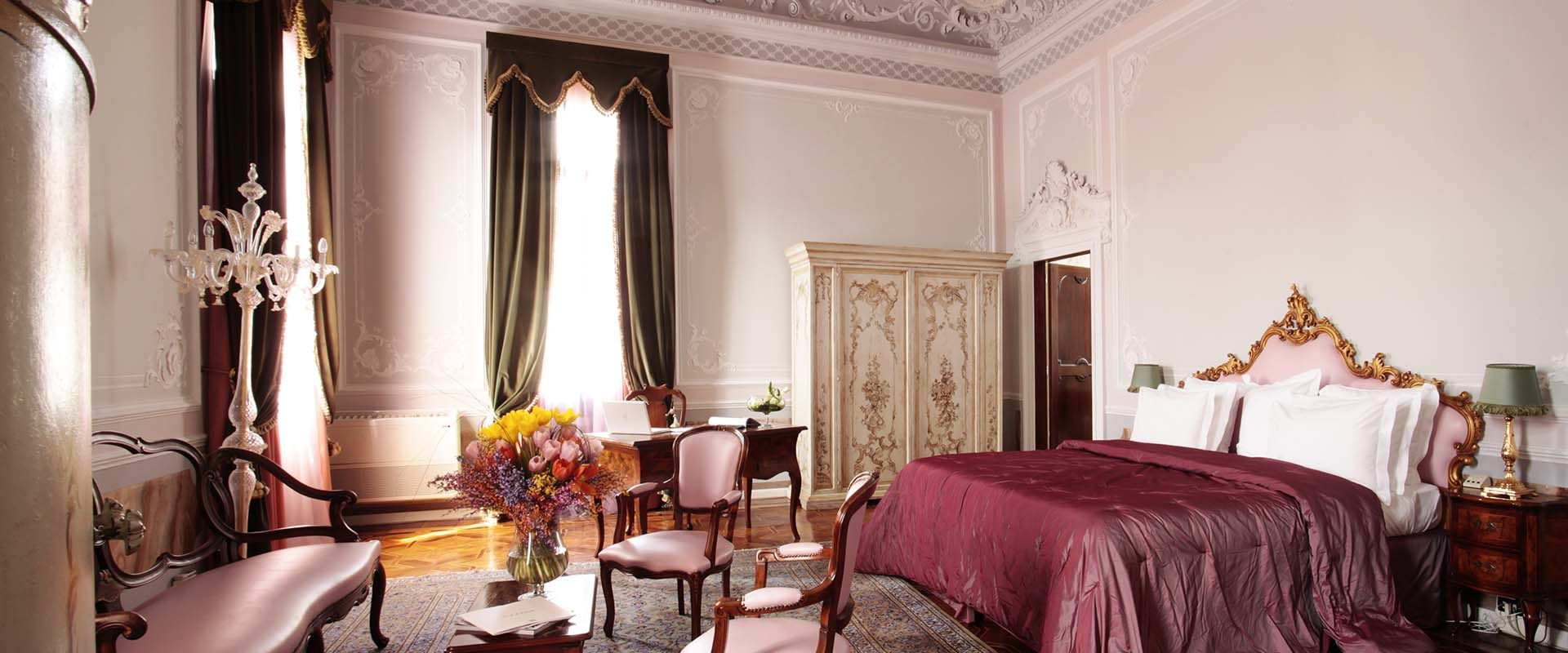 The Junior Suite bedroom with elegant furnishings at the Grand Hotel Dei Dogi in Venice